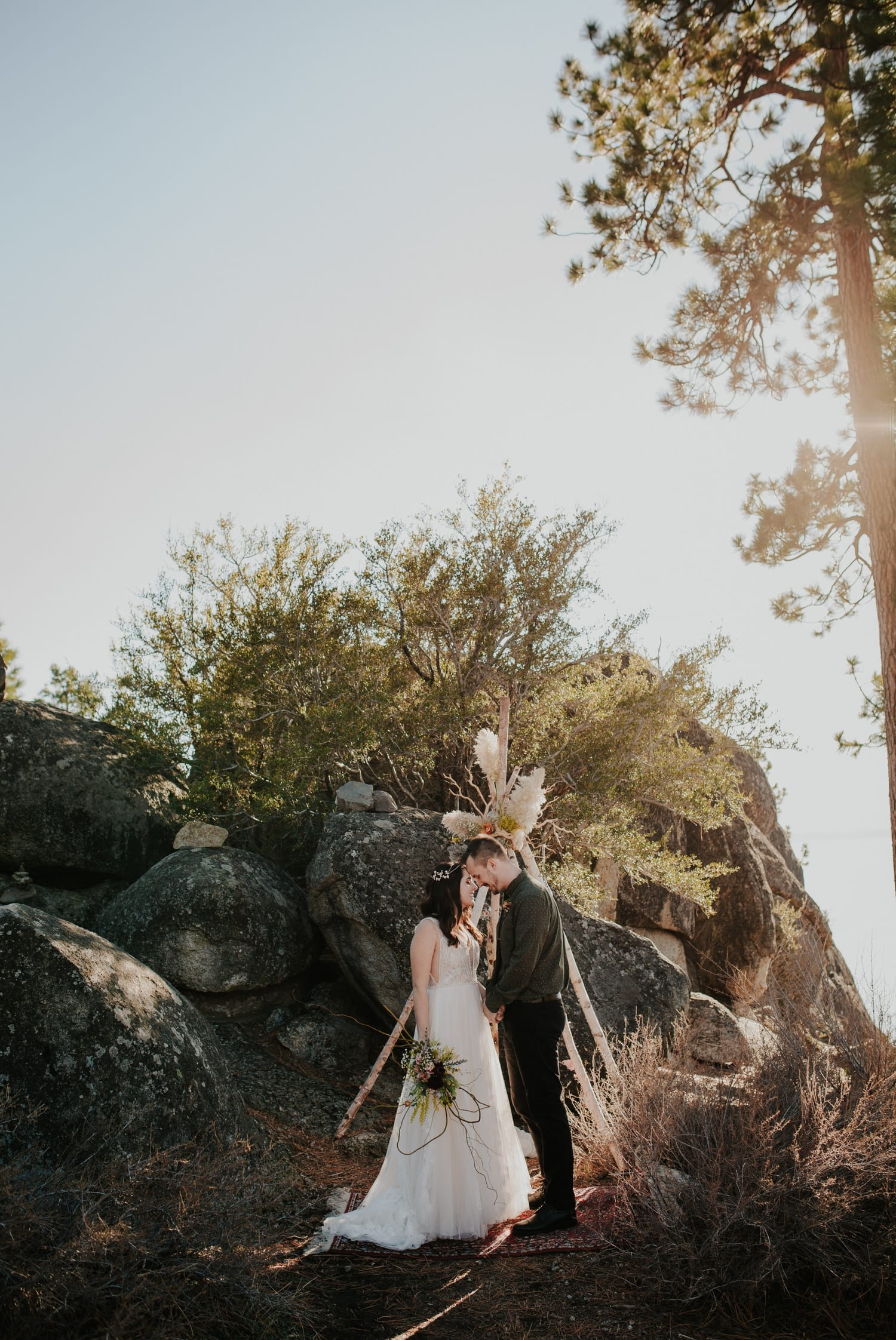 Couple under floral teepee at Lake Tahoe