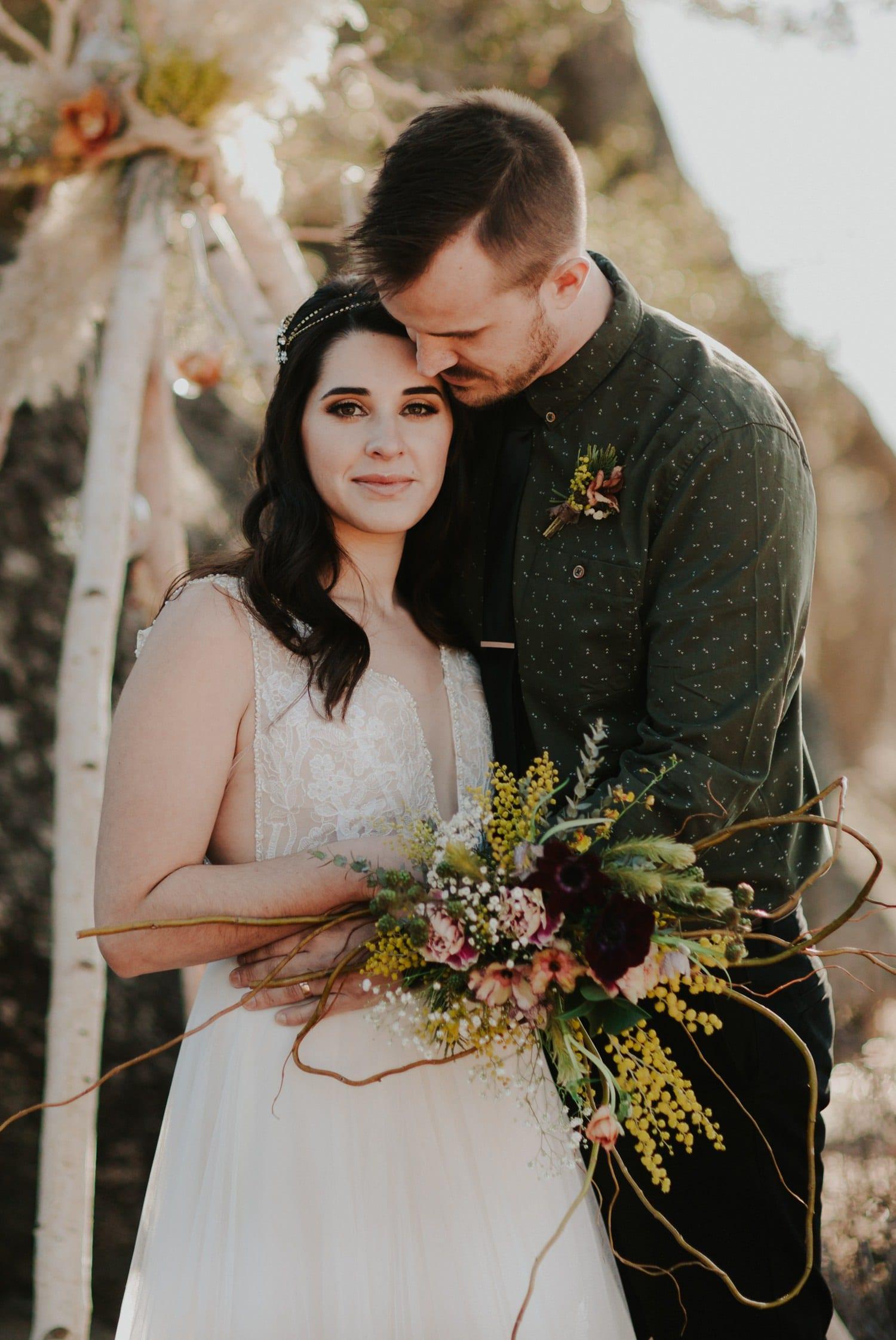 Wedding Couple under floral teepee at Lake Tahoe