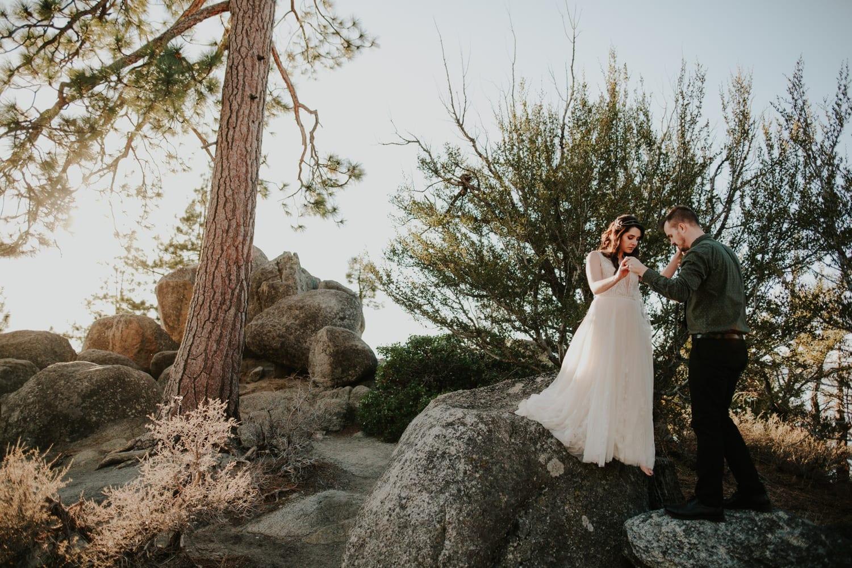 Couple standing on rocks above Lake Tahoe