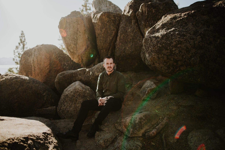 Groom on rock at Lake Tahoe