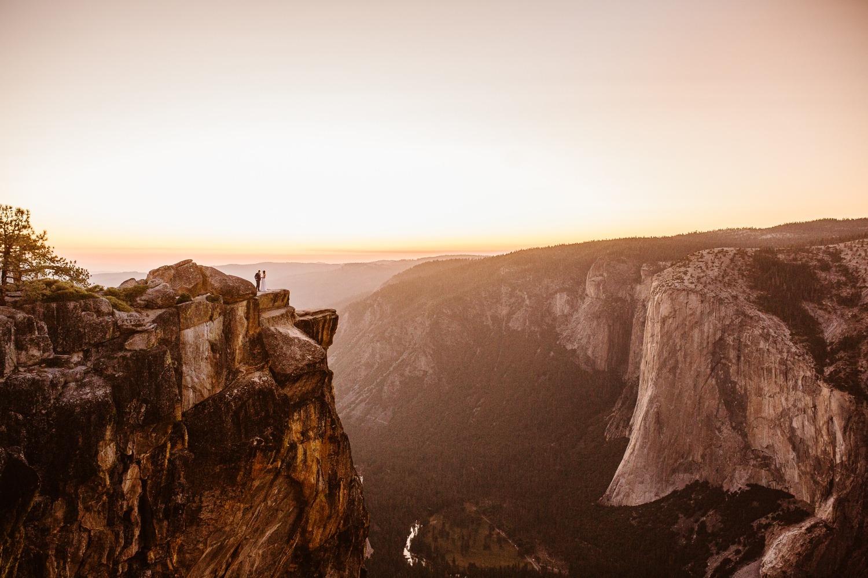 Wedding couple standing at Taft Point Yosemite