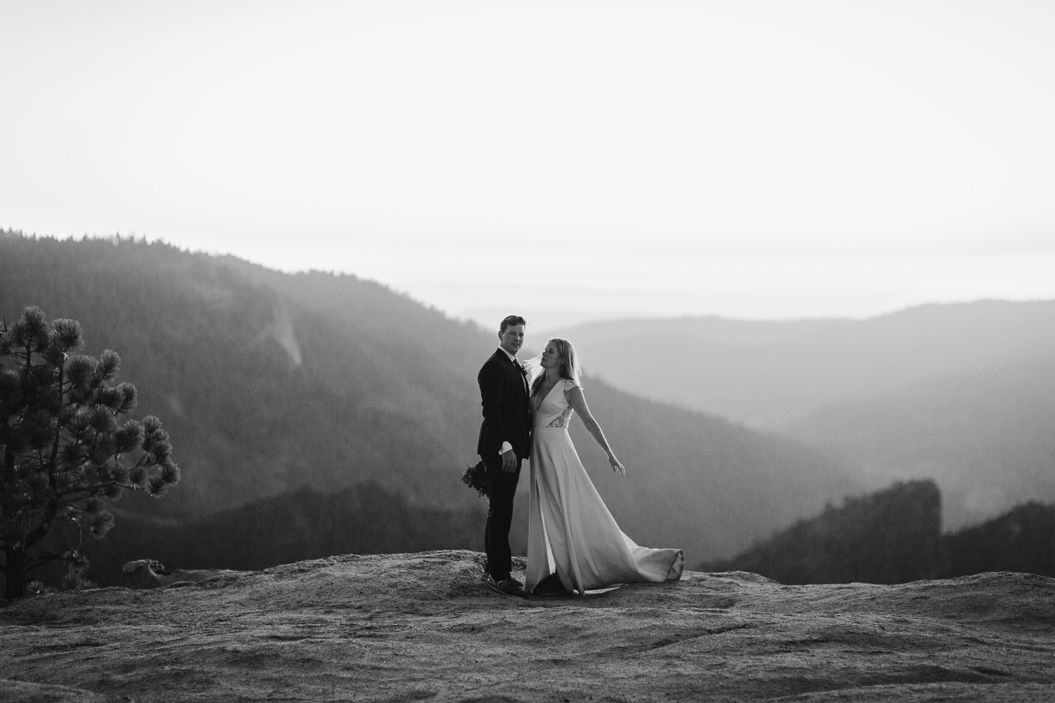 Wedding couple standing at Taft Point
