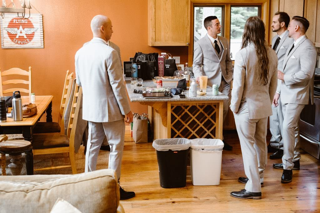 groom gets into dress before outdoor Summer Wedding at Gray's Crossing