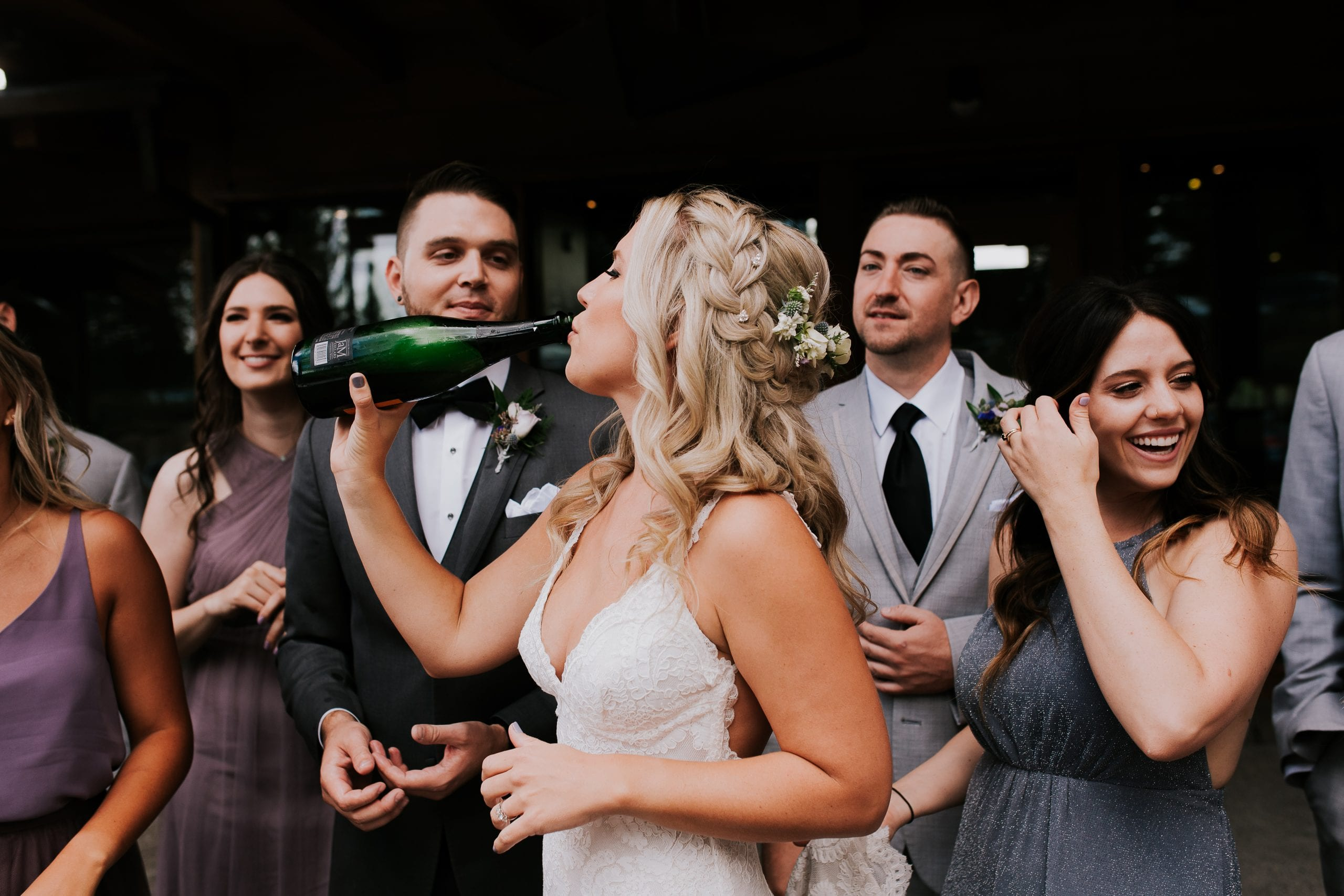 bride drinks champagne at wedding reception