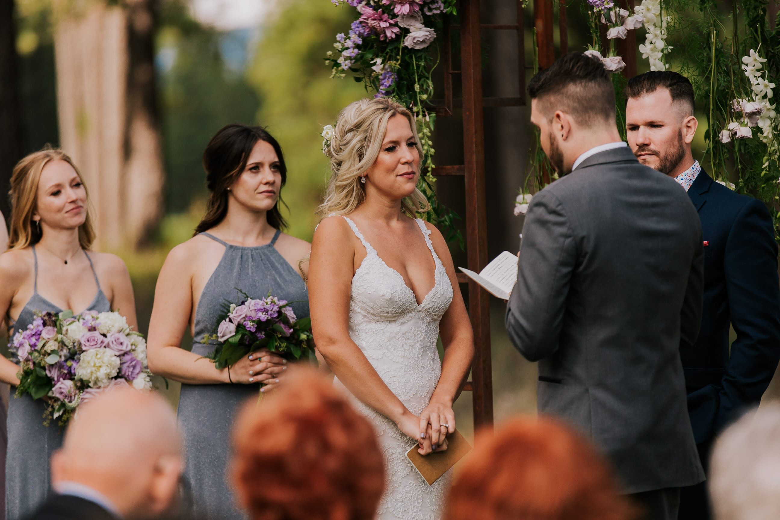 groom reads vows to bride in wedding ceremony