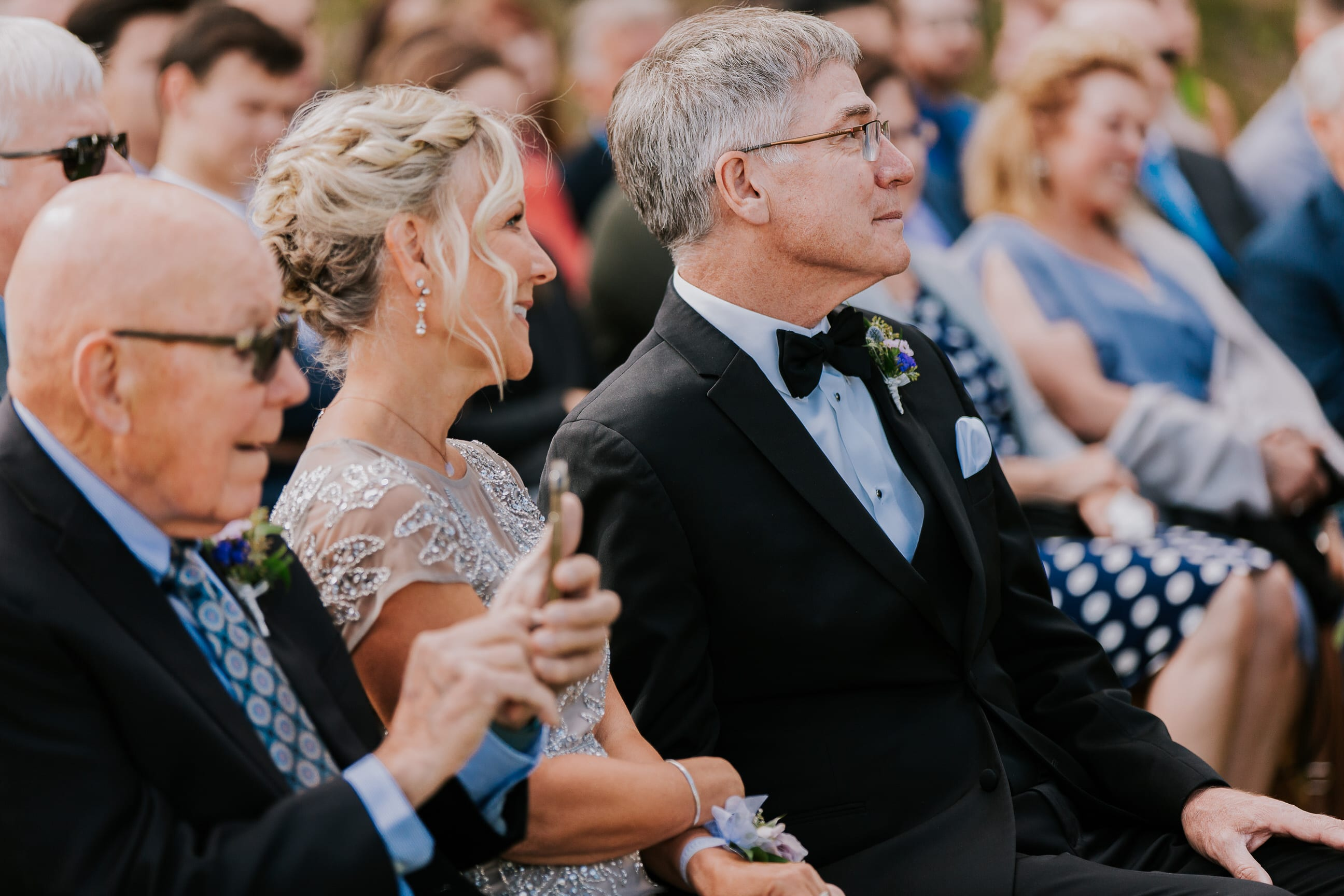 guests watch wedding ceremony