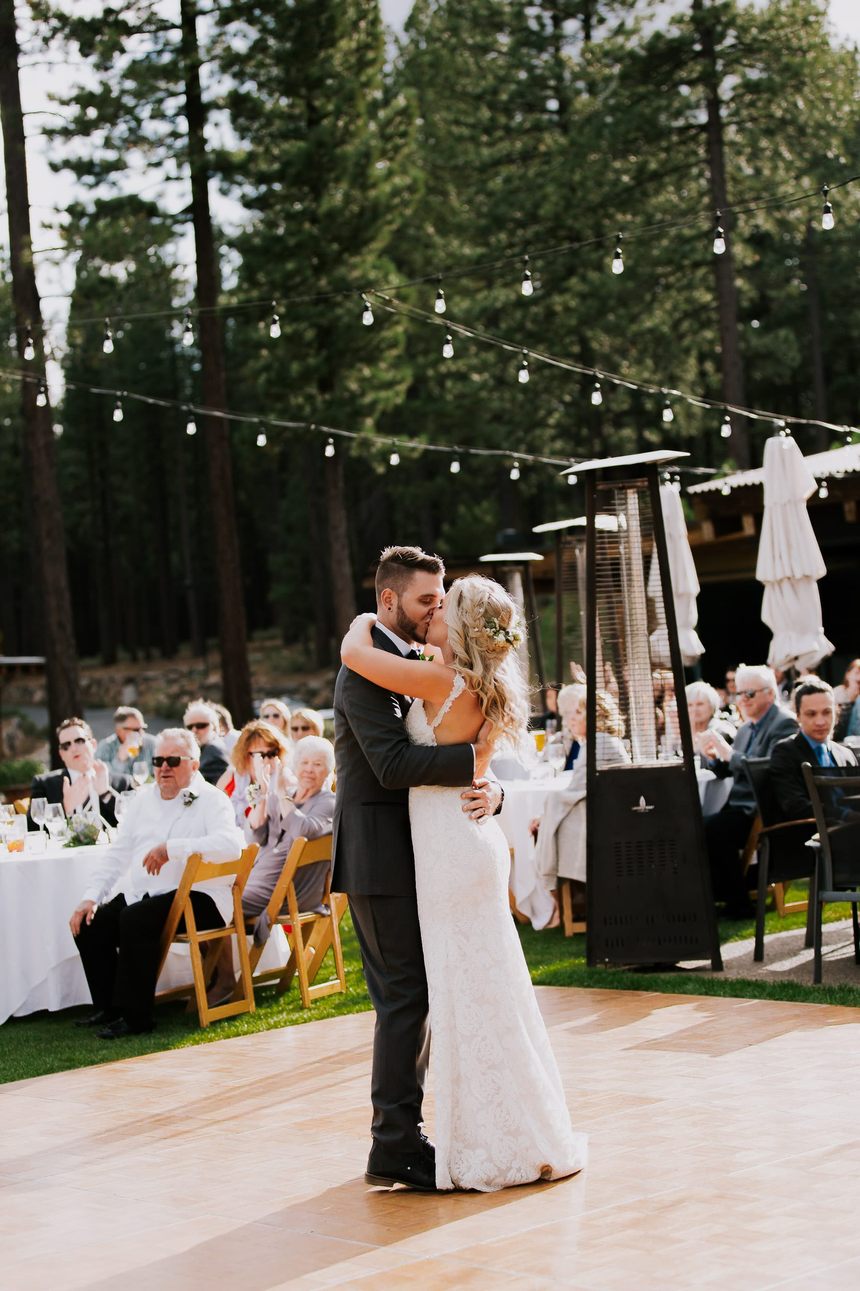 bride and groom walk to dance floor in outdoor Lake tahoe california reception