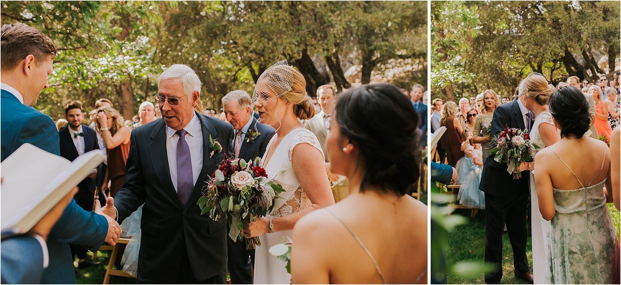 bride and father walk down aisle in Evergreen Colorado outdoor wedding ceremony
