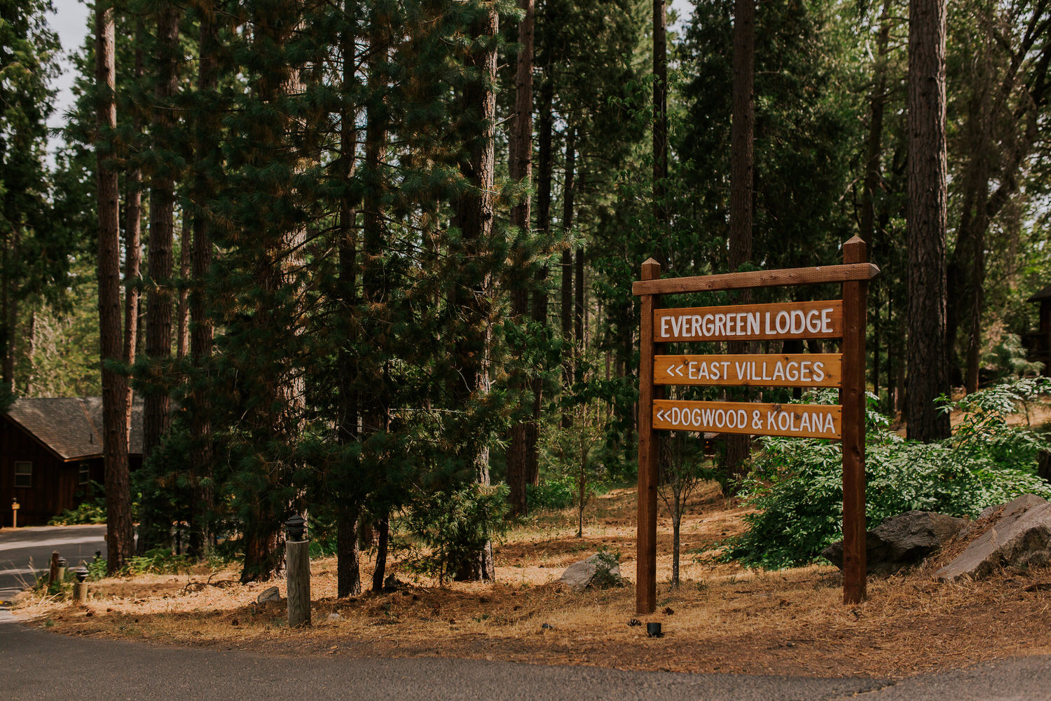 sign for Evergreen Lodge wedding