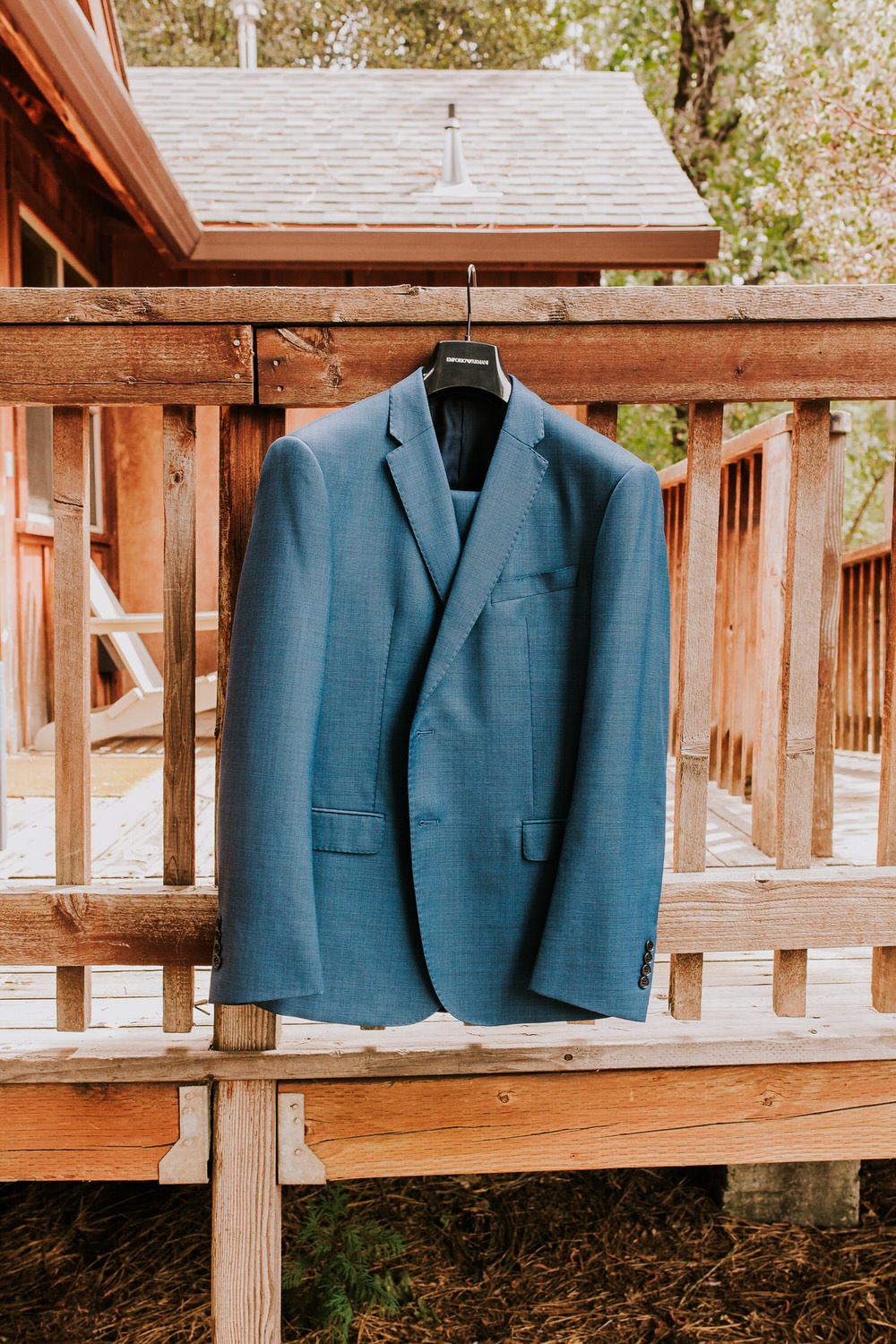 groom suit jacket hanging at Evergreen Lodge for wedding
