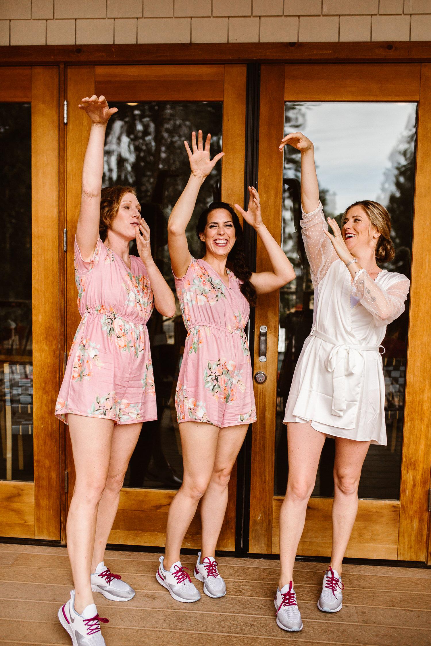 bridesmaids wearing matching running shoes