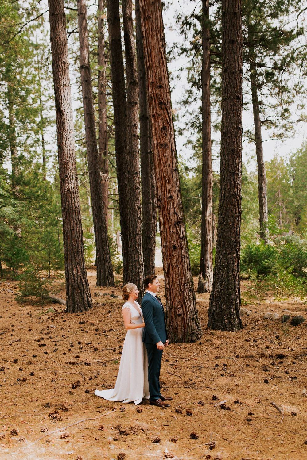 bride and groom first look in Yosemite National Park forest