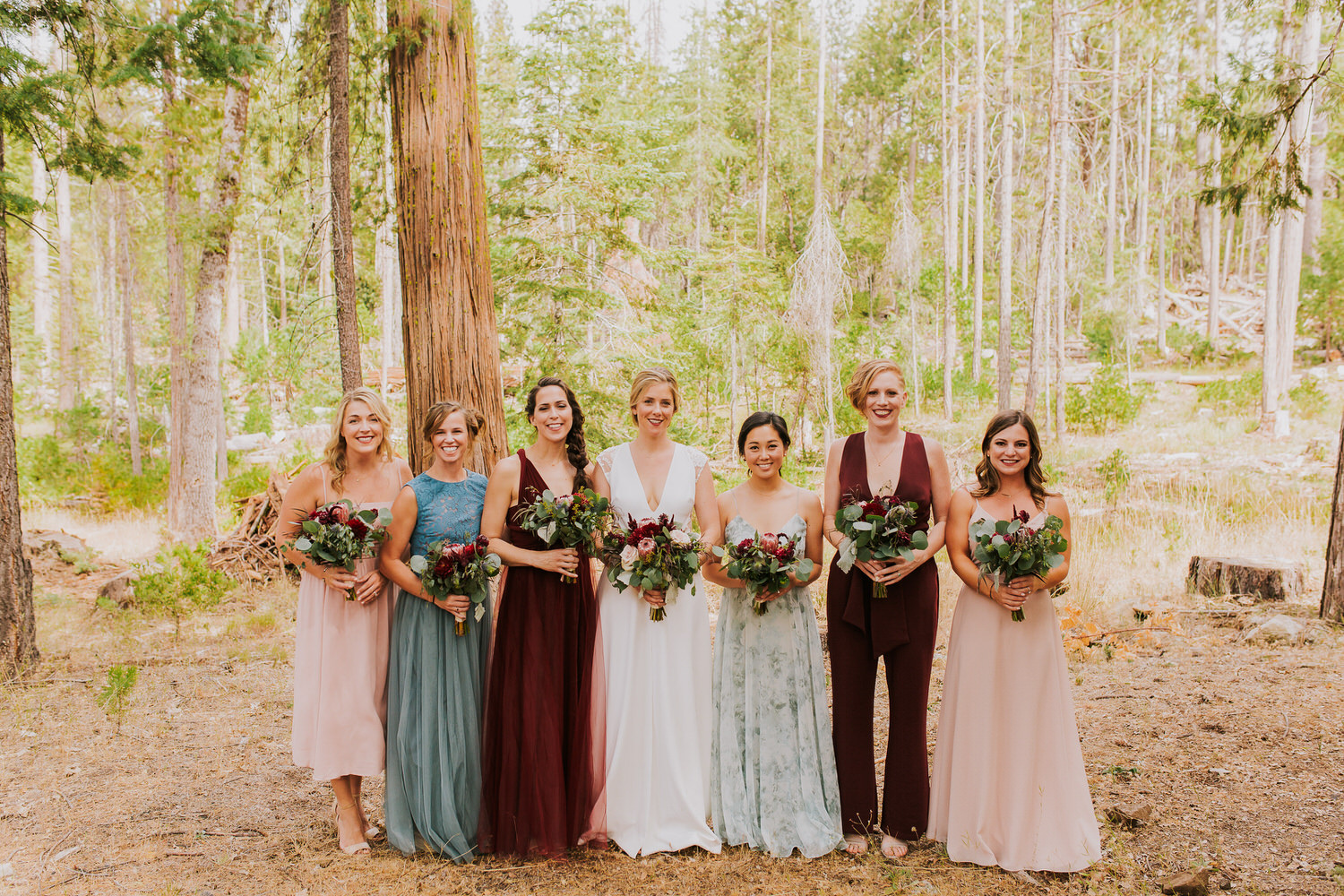 bride and bridesmaids pose for portraits