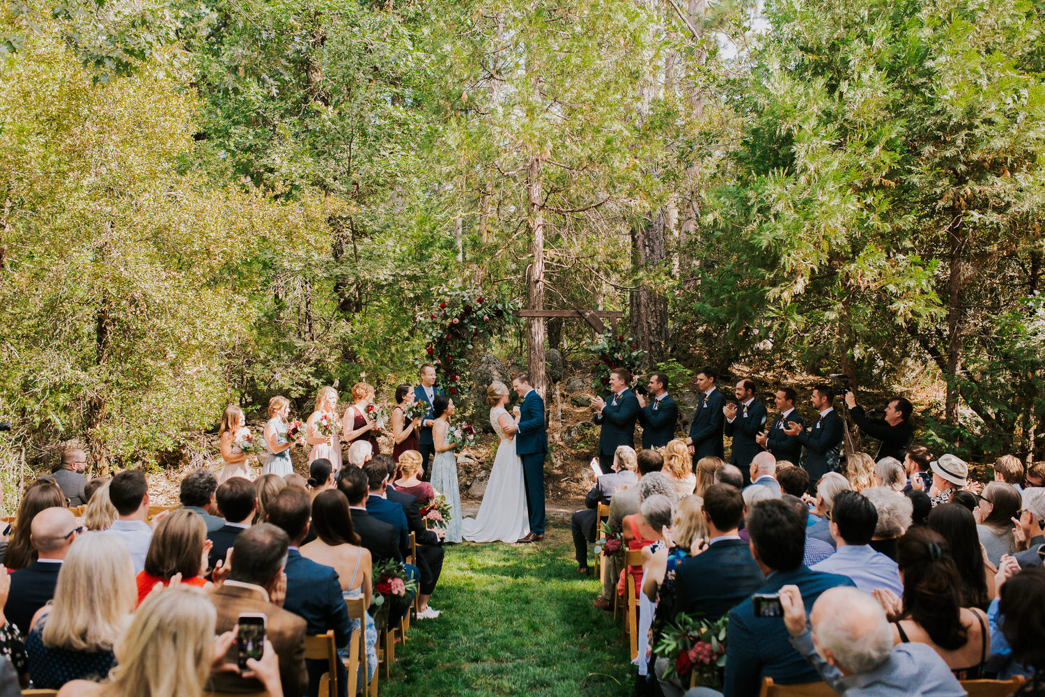 bride and groom celebrate being married in ceremony